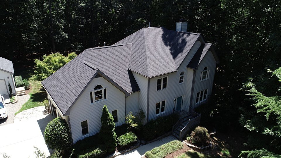 gray roof on home in the woods