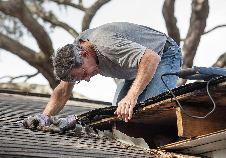 inspecting roof damage
